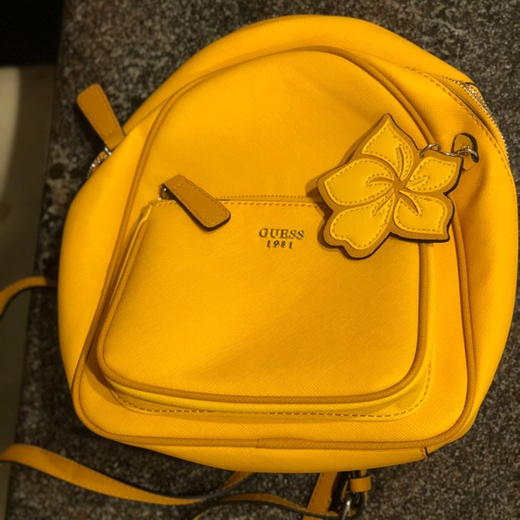 c35c354b694 Guess Bags   Mustard Yellow Baldwin Park Small Backpack   Poshmark